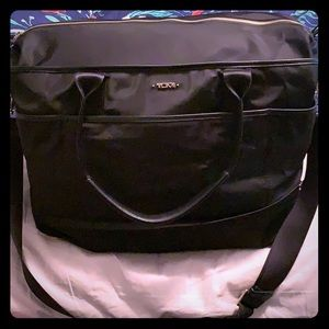 Tumi Black Weekender Bag.